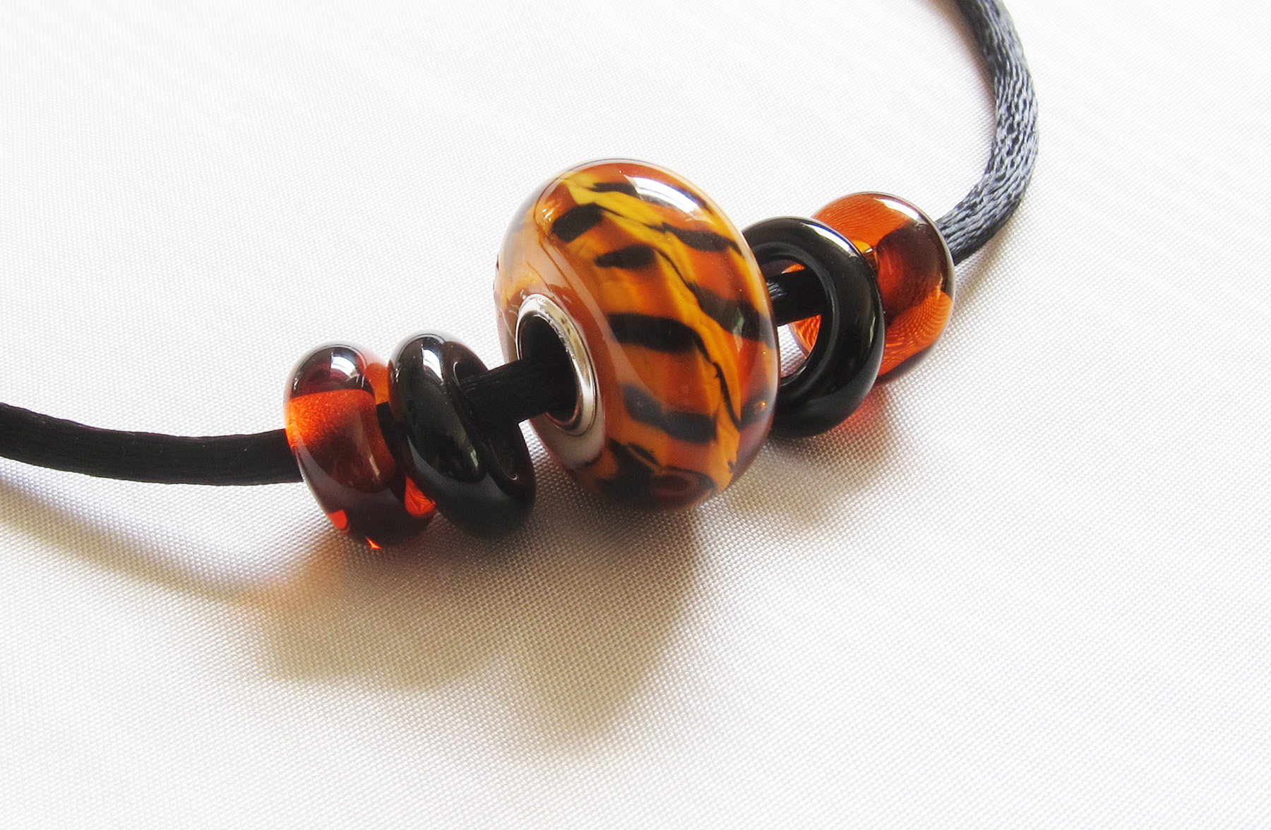 Bad Kitty Tiger Silver Core Bead Necklace on Satin Cord