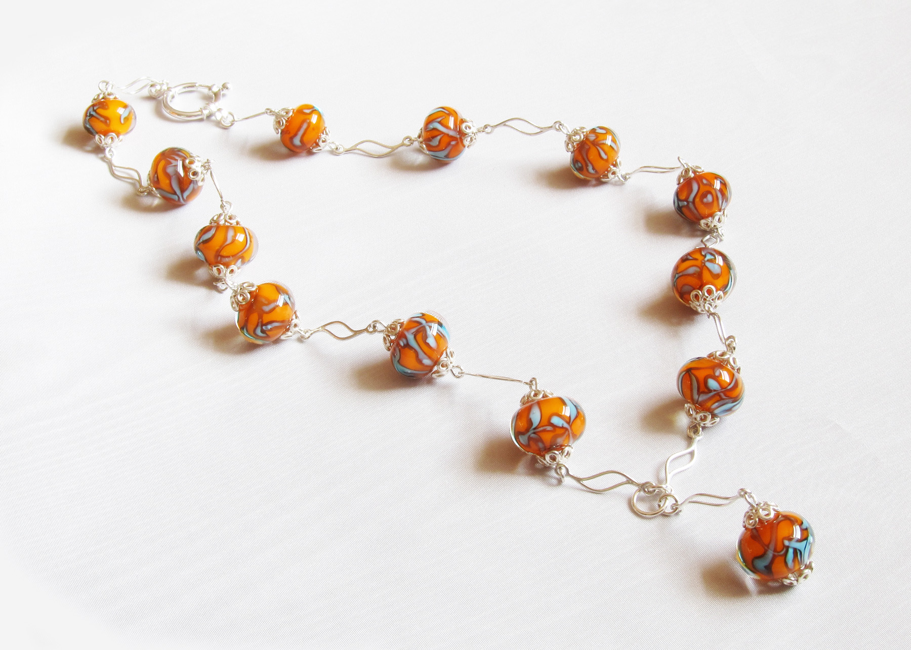 Orange And Turquoise Glass Bead Wavy Silver Necklace