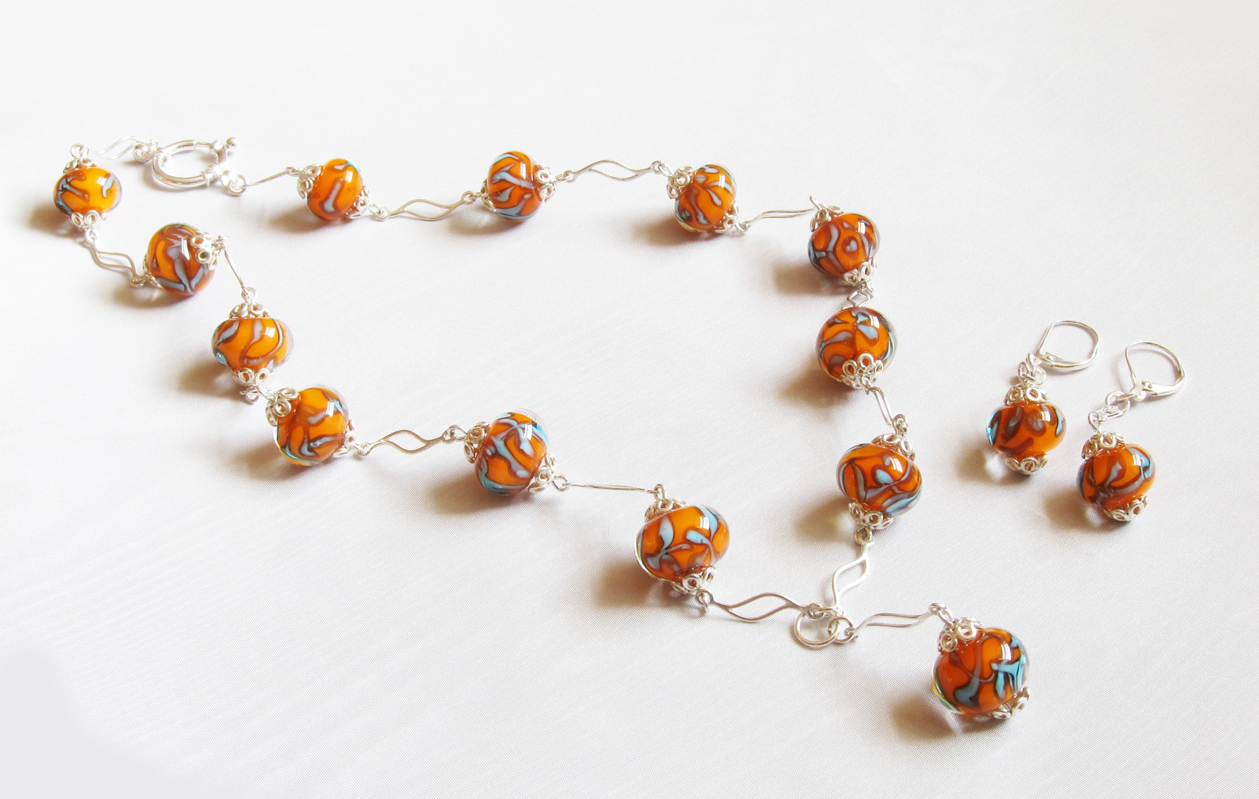 Orange Turquoise Encased Beads Wavy Silver Choker with Drop and Earrings