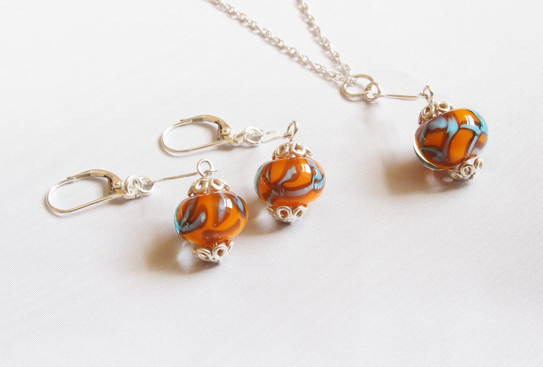 Orange Turquoise Encased Beads Wavy Silver Necklace with Drop and Earrings