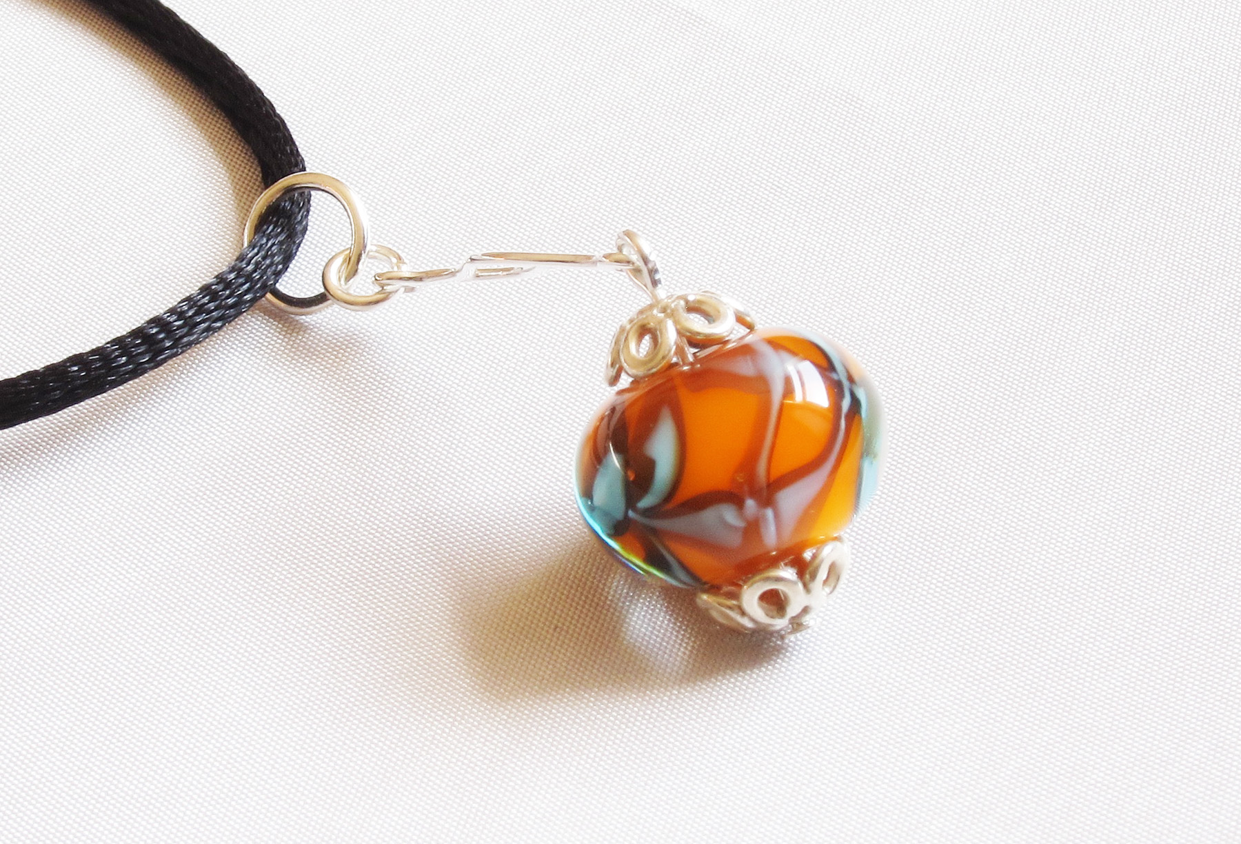 Orange And Turquoise Bead On Wavy Silver Pendant Necklace on Satin Cord
