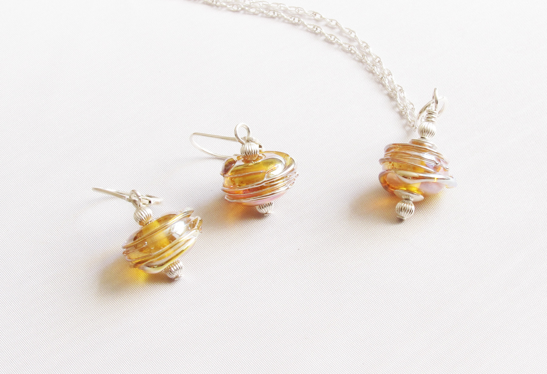 Gold Base Gold Spinning Wrap Pendant on Silver Chain and Drop Earrings on Leverback Set