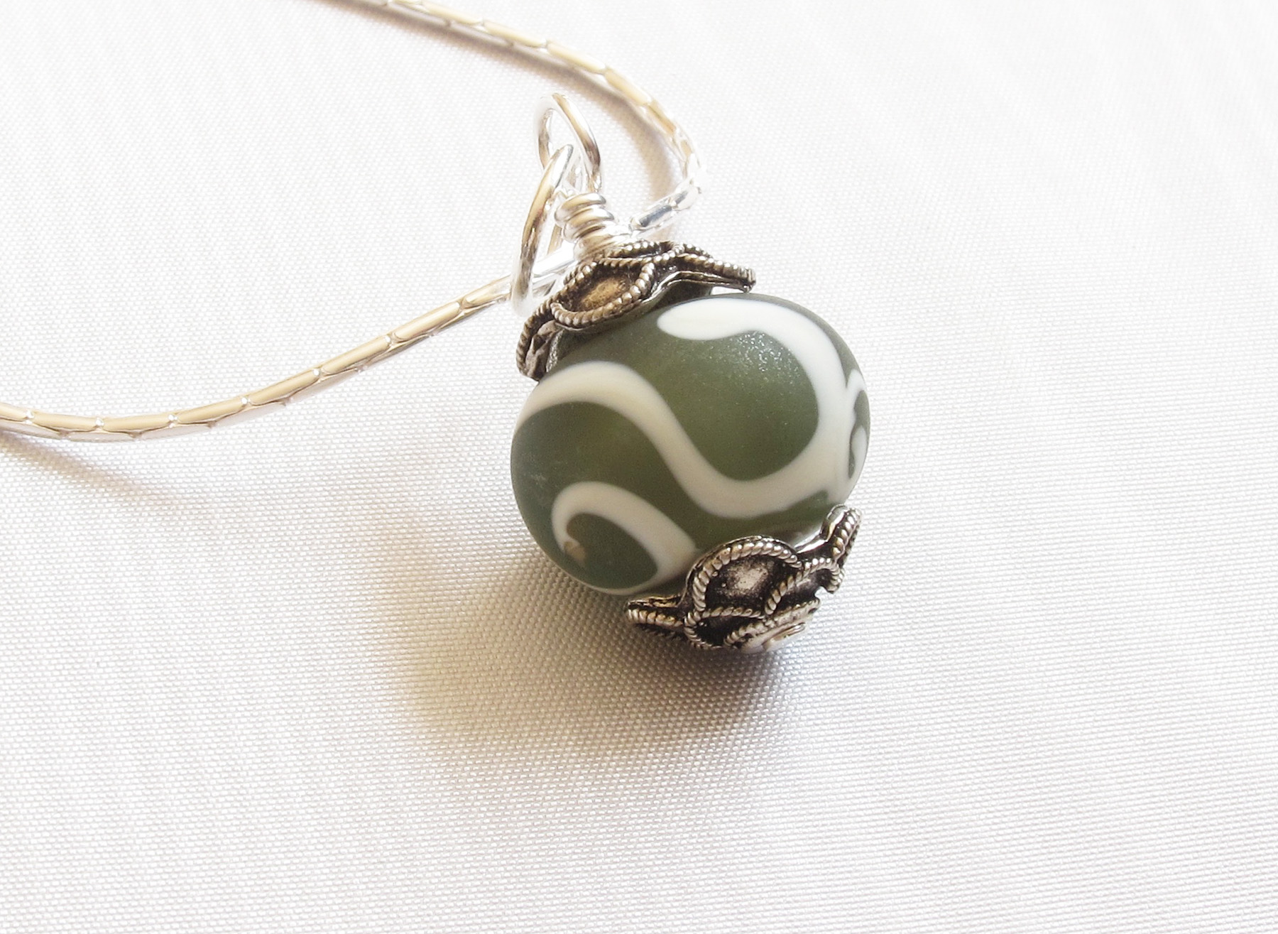 Matte Ivory Swirls Over Deep Grey Pendant on Sterling Silver Chain