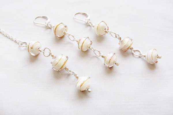 Gold Swirl Over White 3-Bead Dangle Set